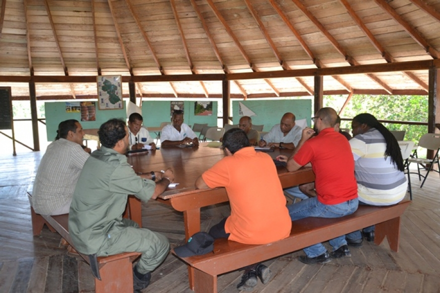 Minister Of Governance, Raphael Trotman, Advisor to the Department of Natural Resources and the Environment, Clayton Hall, meeting with the Executive Council of the North Rupununi District Development Board (NRDDB). (July 27, 2015)