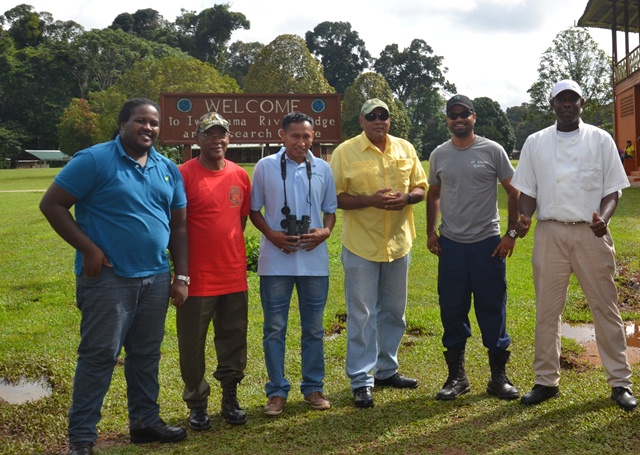 (From Left) Permanent Secretary of the Department of Natural Resources and the Environment, Justin McKenzie, Advisor on Sustainable Development of the Department of Natural Resources, Clayton Hall, Minister of Governance, Raphael Trotman with staff of the Iwokrama Research Centre.(July 26, 2015)