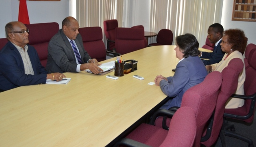 Minister of Governance, Raphael Trotman in discussions with the Assistant Administrator of the United Nations Development Programme (UNDP) Jessica Faieta (backing camera), UN's Resident Coordinator to Guyana, Khadija Musa as Advisor to the Department of Natural Resources and the Environment, Mr. Clayton Hall looks on. (July 23, 2015)