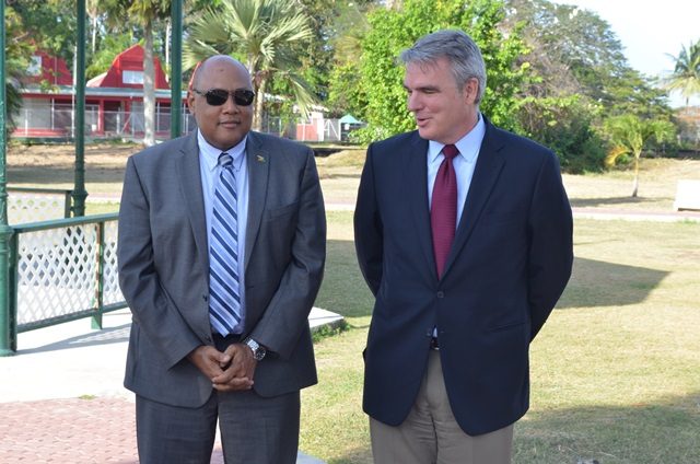 Erik Oswald, Vice President, Americas, ExxonMobil Exploration Company and Minister of Natural Resources, Raphael Trotman at the handing over of the $20M cheque